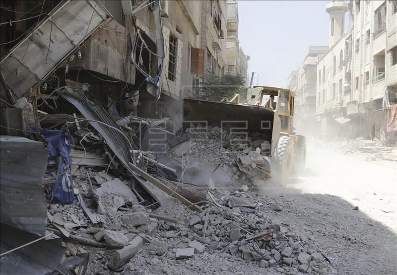 Vista de una calle destruída en Damasco, debido a los ataques que han tenido lugar en los últimos días en Siria. EFE/Archivo